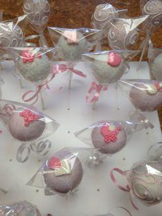 Red velvet flavor cake pops for baby girl theme.
