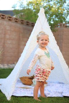 DIY backyard teepee using a light blanket and tent poles via Adornmegirl!