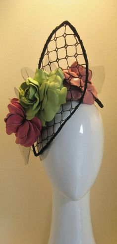 Rambling roses on French trellis.  3 oversized leather roses in pink and lime green sit amoungst a wired frame filled with vintage french veiling to look like trellis.