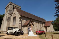 Bride and groom in front of their church with their fabulous cars, photographed by Hampshire wedding photographers Jacqui Marie Photography. VISIT http://jacqui-marie-photography.co.uk for details.  #wedding #photography #weddingphotography #Hampshire #England #uk