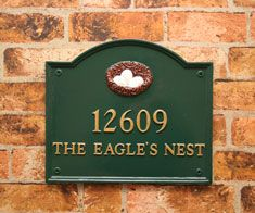 """DDRT15 - 15"""" x 16"""" round top rectangle house sign in racing green with gold letters and nest motif. Sent to Texas, US.  wwww.rockartisansigns.co.uk"""