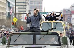 Ravens quarterback and Super Bowl MVP Joe Flacco waves to the crowd gathered on the team's victory parade route in Baltimore. (Photo: Richard Clement / Reuters) #SuperBowl #SB47
