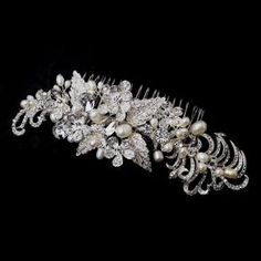 Beautiful hair comb featuring decorative silver ornamentation, sparkling rhinestones and freshwater pearls