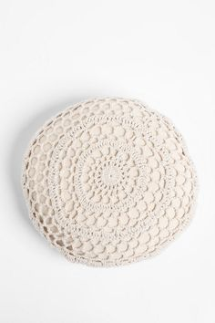 Round Crochet Pillow $34 - I could DIY this with a square doily that I have.
