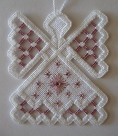 """Hardanger Angel Ornament - Pink Amethyst Hand-stitched Hardanger Angel ornament. Stitched on 28 count aida fabric with White DMC pearl cotton thread. Needle-weaving is done with Pink Amethyst DMC light effects, jewel effects thread, E316. Angel is approximately 2 ½"""" wide by 3"""" tall."""