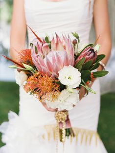 sunset inspired bouquet // photo by Sarah Joelle Photography // View more: http://ruffledblog.com/colorado-boho-wedding/