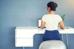 50 Daily Habits of Naturally Thin People -- At your desk chair, pretend you're going to sit but don't—stop and come back up without using your a... - iStock/PeopleImages