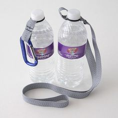 Water bottle holder - made with ribbon and a rubber O-ring (found in the plumbing department of any hardware store). Water Bottle Carrier, Water Bottle Holders, Water Bottles, Diy Bottle, Bottle Bag, Plastic Bottle, Diy O Rings, Camping Crafts, Fun Crafts