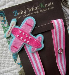 This is an adorable ribbon pacifier clip that has been embellished with a felt applique design. Pacifier clips are used to keep little ones