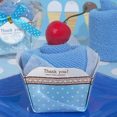 """""""Sweet treats"""" towel cake favors. Each cleverly designed favor is packaged to resemble a delicious cup cake in a unique cup cake box that is actually a useful 100% cotton hand towel."""