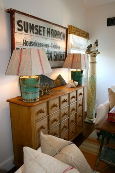Great piece...and those bucket lamps are different. A little beach house decor perhaps.