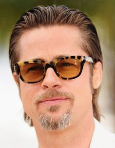 915aedef383 Brad Pitt looks charming in his custom-made Tom Ford sunglasses in Havana  frame and dark lenses.