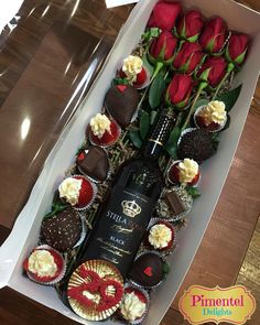 Cream cheese and chocolate covered strawberries, Stella Rosa Black wine, and red roses!