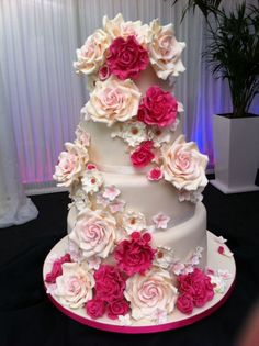 """A Rose, Is A Rose, Is A Rose"" ~    		  wedding cake with cascading large pale pink  sugar roses, soft pedalled hot pink shear roses and white assorted flowers  ~ all edible"