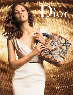 For the new Lady Dior campaign Marlon Cotillard is photographed by Peter…