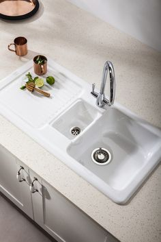 Bushboard S Encore Solid Surface In Ivory Gl Shown With Franke Vbk651 Inset Ceramic Sink And Eiger