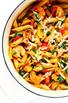This Cajun Shrimp Pasta recipe is made with the most delicious creamy alfredo sauce, colorful veggies, and zesty shrimp (or chicken, sausage, or your preferred protein). It's comfort food with Cajun Shrimp Recipes, Cajun Shrimp Pasta, Seafood Recipes, Pizza Recipes, Bread Recipes, Easy Recipes, Cookie Recipes, Vegan Recipes, Dessert Recipes