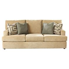 Beige sofa with 3 back cushions and fiber-wrapped foam padding.   Product: SofaConstruction Material: Polyester...