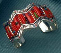 Raymond Yazzie (Navajo). Silver inlaid with coral, lapis and turquoise