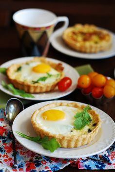 Baked egg cups with spinach, cheese, and bacon! The perfect breakfast in one adorable package :-)