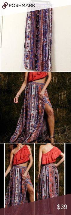 """""""Free people styled"""" gypsy skirt Based on the style of Free People. Light and flowy. NWOT A woven maxi skirt featuring allover gypsy print. Side zipper and side slit, makes this skirt very flowy. The gypsy-styled print features this skirt a unique and exotic flavor. 85% polyester, 10%cotton, and 5% spandex. Size XL-waist-31.5""""-32.5"""" and length: 40.5"""" Size L-waist 29.5""""-30.5 and length 40.5"""" Skirts Maxi"""