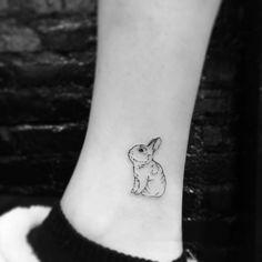 Minimalist bunny tattoo on leg