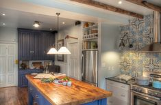 Superb Cement Tile vogue Philadelphia Traditional Kitchen Decoration ideas with accent tiles blue cabinets butcher block countertops ceiling lighting dark floor dining hutch exposed
