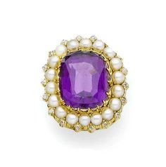 An amethyst, pearl and diamond ring