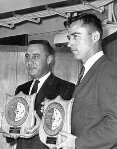 Gemini 3 astronauts Gus Grissom and John Young with plaques presented to them by crew off U.S.S. Intrepid.