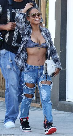 Relaxed and laughing, Christina Milian could not look more relieved that her secret romance is out in the open as she headed out in just a bra in Los Angeles on Friday. Hottest Female Celebrities, Girl Celebrities, Ripped Jeans, Mom Jeans, Cut Out Jeans, Most Beautiful Black Women, Women Lawyer, Christina Milian, Casual Chic Style