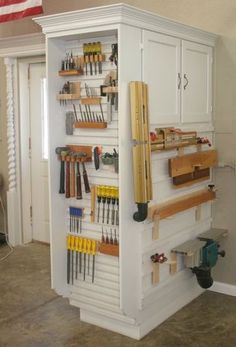Organized tools! This would hold A LOT of tools & supplies in the craft room. You could enclose the end with a drop down work table that hides everything when not in use. You could also just add shutter like doors to that end cap. There are so many options to customize this unit. See photos of the entire shop and all the great storage ideas.
