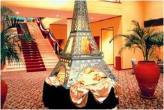 What is more burlesque than your very own Eiffel tower, use lots of good lighting to make it look spectacular.