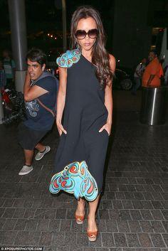 Victoria Beckham stays fashion savvy picking husband David up at LAX #dailymail