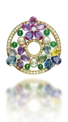 A MULTI-GEM 'SAPPHIRE FLOWER' BROOCH, BY BULGARI Designed as three flowerheads, the petals as pear-shaped fancy coloured sapphires, to the button-shaped cultured pearl, emerald bead detail and diamond-set circular outline and centre, mounted in gold, 2004, 4.3 cm, in black leather Bulgari case Signed Bulgari