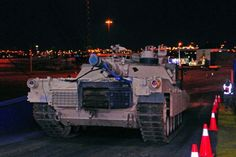 An Army M1 Abrams tank is offloaded from a cargo ship, Jan. 6, 2017, at a port in Bremerhaven, Germany. (Elizabeth Tarr/U.S. Army)