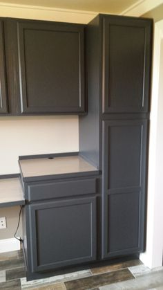 Finished cabinets painted in Behr Cracked Pepper
