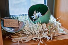 Mysterious Paper Sculptures-in early July the Scottish Storytelling Centre found a dragon nesting in a window.