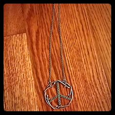 Peace sign necklace Awesome earthy necklace with peace sign charm. Barely worn. Perfect for your boho flair outfits Jewelry Necklaces