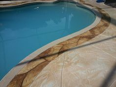 """FlagStone Pool Deck with """"cool white"""" patio in Cape Coral, FL see more at msdcurbing.com"""