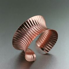 Looking for a conversation piece? With its corrugated texture and sleek #anticlastic curves, this #Copper #Bangle Bracelet is guaranteed to make a stylish statement. #handmade #jewelry #copperjewelry #johnsbrana