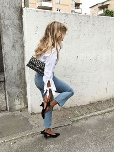 Simple style outfits White button up with tie sleeve detail Cropped raw hem denim black pointed toe sling backs Edgy Outfits, Mode Outfits, Fashion Outfits, Women's Fashion, Fashion Styles, Street Fashion, Fashion Tips, Fashion Trends, Spring Street Style