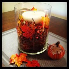 DIY fall table centerpiece. Easy to make under $15! Perfect for any decor to celebrate Autumn. Follow me on Facebook for more crafts, designs & photos at Kristin McComb Designs.