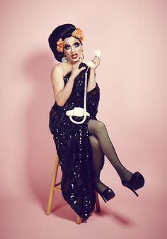 Off the shoulder black dress in sequins, Roy Haylock. Earrings, Vicki Sarge. Tights, Wolford. Shoes, Bianca's own.