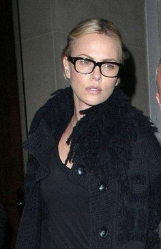 Davis Vision - Charlize Theron goes all black with geek-chic specs. #eyeglasses