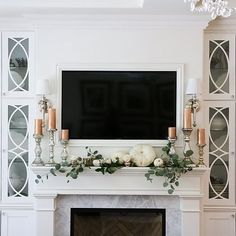 I'm so in love with this simple but stunning Fall mantel by my darling friend Randi @randigarrettdesign. 💓 Her Fall decor was so inspiring this year and now she has mixed it all up again for Halloween! 🕷️️ I know Randi personally and you won't find a more sincere and amazing person, friend or mom.