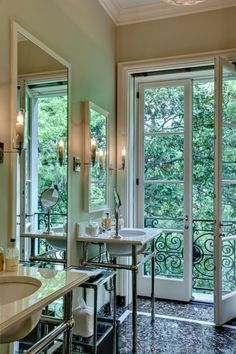 loving this bathroom with the big windows where the only thing you see are the trees
