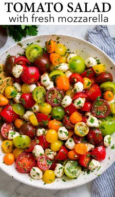 Tomato Salad - This vibrant and flavorful salad is made with a colorful array of mildly sweet cherry and grape tomatoes, itty bitty fresh mozzarella pearls and it's all tossed in a refreshing garlic-herb vinaigrette dressing.Easy to make yet sure to satisfy! #tomato #salad #sidedish #summer Tomato Mozzarella Salad, Cherry Tomato Salad, Tomato Salad Recipes, Fresh Mozzarella, Cherry Tomatoes, Fresh Tomato Recipes, Easy Salads, Summer Salads, Clean Eating Guide