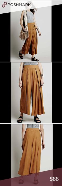 """Free People Beach gold mustard Wide Leg Pants XS Free People Beach gold mustard curry Wide Leg Palazzos Kats Pants soft cotton jersey with a dramatic wide leg, front pleat and stretchy waistband pull on styling * Made in America New Without Tags  *  Size: X Small  28"""" around waist 15"""" rise 30"""" inseam 58"""" around bottom opening Free People Pants Wide Leg"""