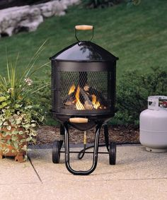 black metal wood burning outdoor fireplace with chimney fire place rh pinterest com backyard fireplace portable outdoor portable fireplace nz
