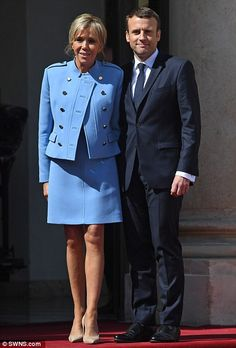 Hollande said he wanted today's handover of power to Macron (pictured with his wife Brigitte) to be 'simple, clear and friendly'